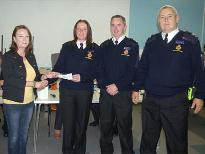 Activ8 presenting a cheque to HM Coastguards
